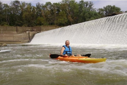 kayak in front of dam