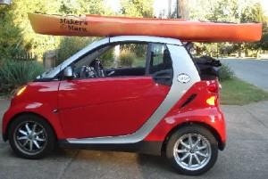 Maker's Mark Kayak on top of Smart ForTwo Cabriolet