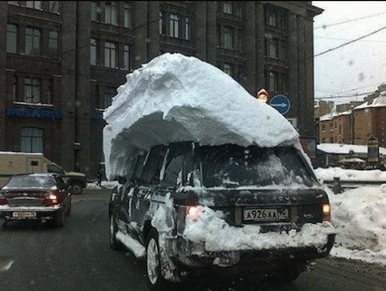 Car covered with snowdrift
