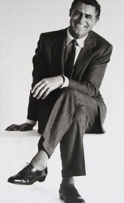 Handsome Cary Grant In Suit Seated Legs Crossed
