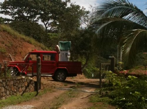 Refrigerator being delivered by taxicab in Costa Rica