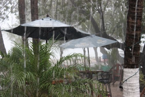 Costa Rica Rain on patio umbrellas